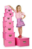 Little cute girl with lots of boxes — Stock Photo