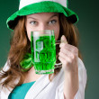 Young girl in saint patrick celebration concept — Stock Photo #21217181