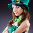 Young girl in saint patrick celebration concept — Stock Photo