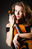 Woman performer with violin in studio — Stock Photo