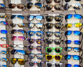 Many sunglasses on display in shop — Foto de Stock