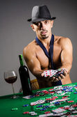 Naked broke businessman in casino — Stock Photo