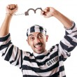 Convict criminal in striped uniform - Stock Photo