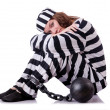 Prisoner in striped uniform on white — Stock Photo