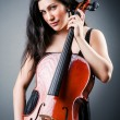 Woman cellist performing with cello — Stockfoto