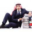 Arab businessman with many folders on white - Stock Photo