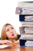 Woman with pile of papers — Stockfoto