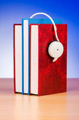 Concept of audio books with earphones on white — Stockfoto
