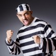 Convict criminal in striped uniform — Stock Photo #21269501