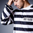 Convict criminal in striped uniform — Stock Photo #21269503