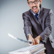 Businessman cutting the pile of paper — Stock Photo