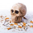 Antismoking concept with cigarettes and skull - Stock Photo