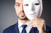 Man with masks in hypocrisy concept — Stock Photo