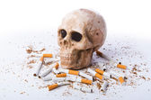 Antismoking concept with cigarettes and skull — Stock Photo