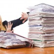Woman with pile of papers — Stock Photo #21772857