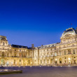 Stock Photo: PARIS - AUGUST 18: Louvre museum at sunset on August 18, 2012 in