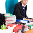 Stock Photo: Young busy businessmat his desk