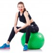 Young girl with swiss ball doing exercise — Stock Photo