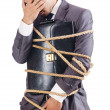 Stock Photo: Businessman tied up with rope