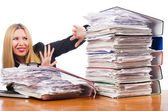 Woman with pile of papers — Stock Photo