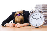 Woman businesswoman with giant alarm clock — Stockfoto