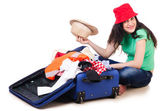 Young girl packing for vacation — Stock Photo