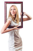 Woman with picture frame on white — Stockfoto