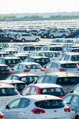 TUSCANY, ITALY - 27 June: New cars parked at distribution center — ストック写真