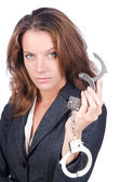 Female businesswoman with handcuffs on white — Foto de Stock