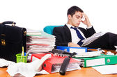 Young busy businessman at his desk — Stock Photo