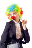 Woman clown in business suit — Stock Photo