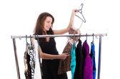 Donna che cerca nuovi vestiti su bianco — Foto Stock