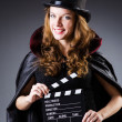 Stock Photo: Woman with movie clapper board