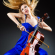 Attractive woman with cello in studio - Stock Photo