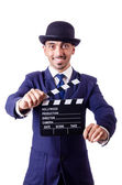 Man with movie clapper isolated on white — Stock Photo