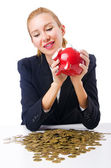 Woman breaking piggy bank for savings — Stock Photo