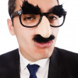 Funny businessman with eyebrows and moustache — Stock Photo #22567333