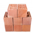 Stack of clay bricks isolated on white - Zdjęcie stockowe