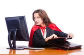 Superwoman worker working in office — Stock Photo