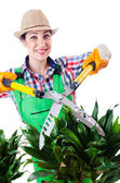 Woman gardener with shears on white — Stock Photo