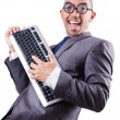 Nerd businessman with computer keyboard on white - Zdjęcie stockowe