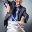 Businessman cutting the pile of paper — Stock Photo #22944148