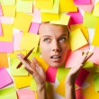 Businesswoman with lots of reminder notes — Stockfoto
