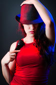 Female performer at disco with mic — Stock Photo