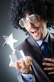 Singer receiving star prize award — Stock Photo