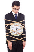 Businessman tied to clock on white — Stock Photo