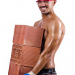 Muscular builder with bricks on white — Stock Photo