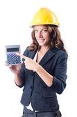 Constructor femenina con la calculadora en blanco — Foto de Stock