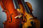 Violin in dark room - music concept — Stock Photo