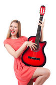 Female guitar player isolated on white — Stock Photo